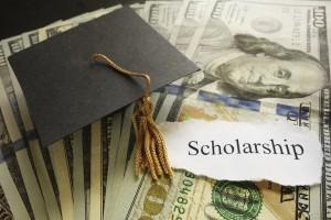 Mini graduation cap on cash with Scholarship paper note