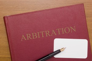 Code of Arbitration - the book and business card for a lawyer.